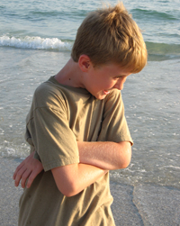 Alex posing on the beach